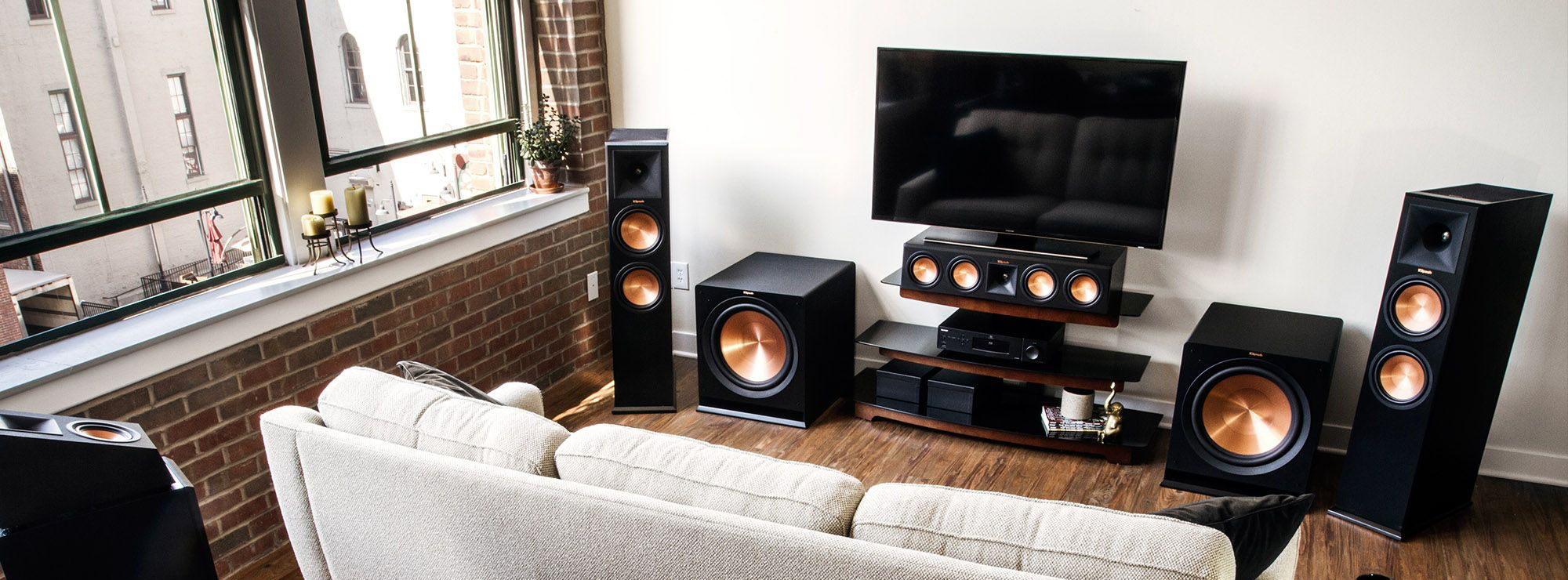 Klipsch Dolby Atmos home theater system in a living room with tv and couch