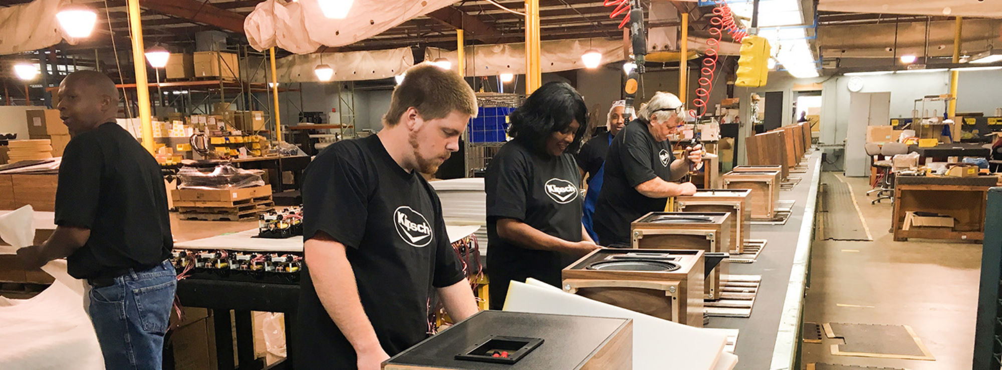 Klipsch employees building speakers on an assembly line