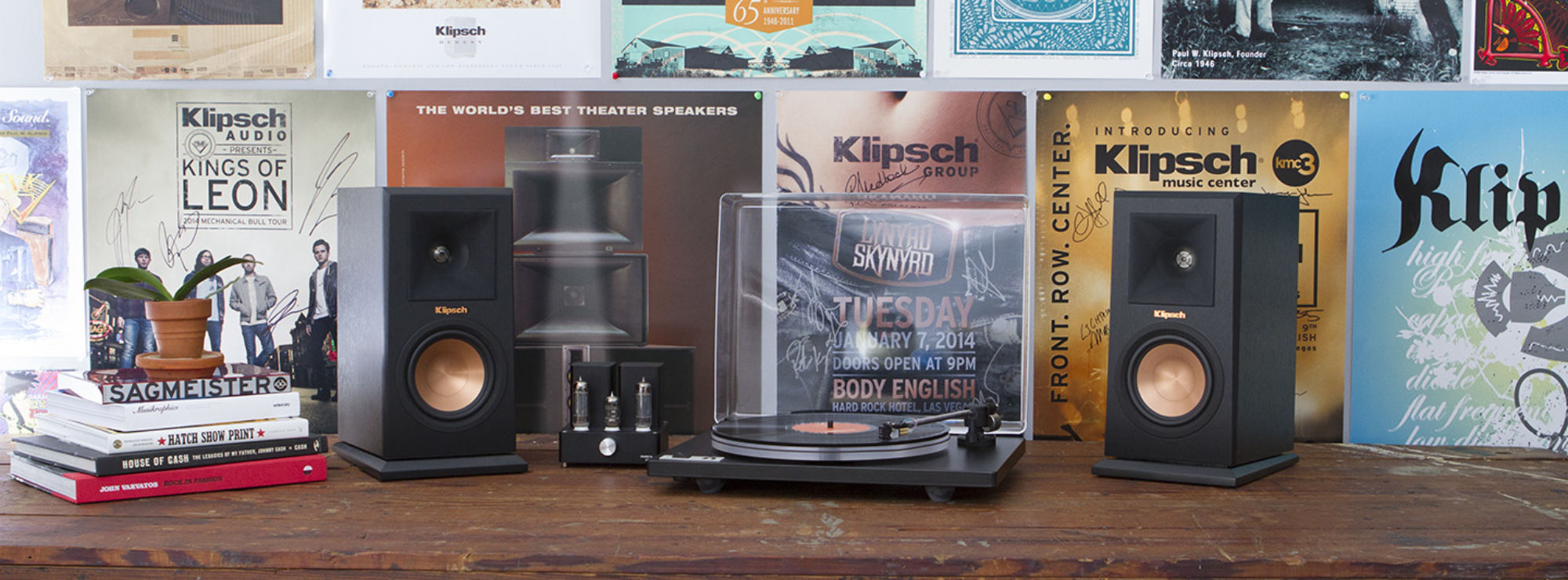 U-Turn turnable with two R-15PM powered speakers in front of Klipsch plaques
