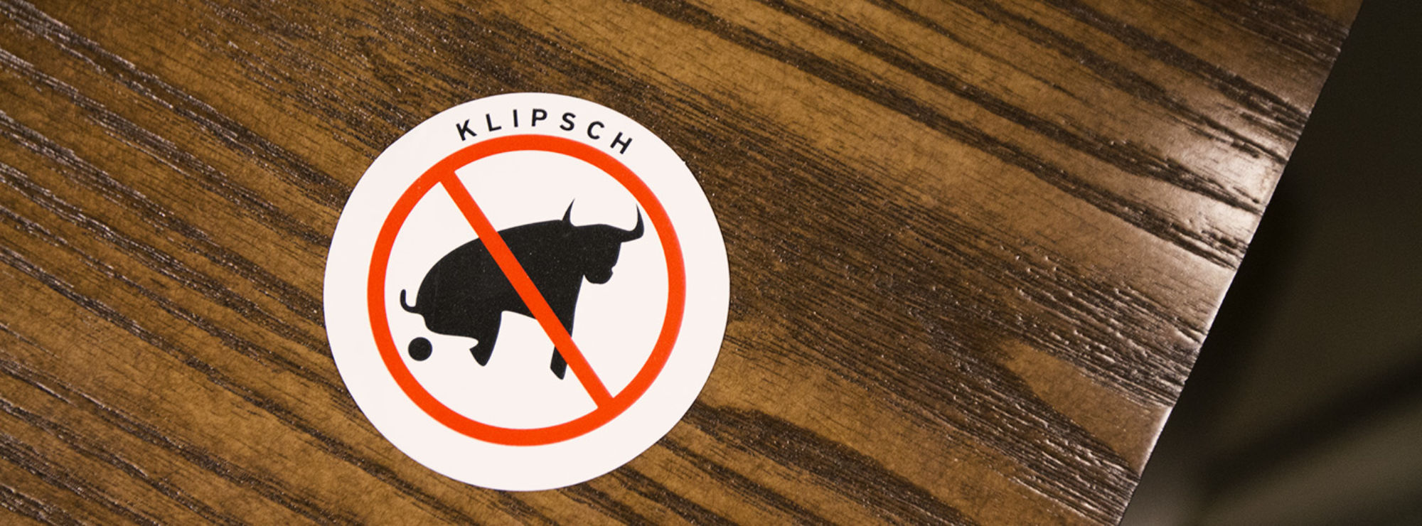 No Bullshit sticker on a wood table