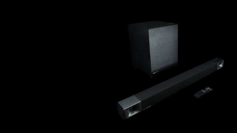 Klipsch Cinema 400 Sound Bar and Wireless Subwoofer with remote on right side desktop