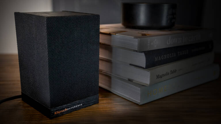 Klipsch Surround 3 Speaker next to a stack of books Desktop