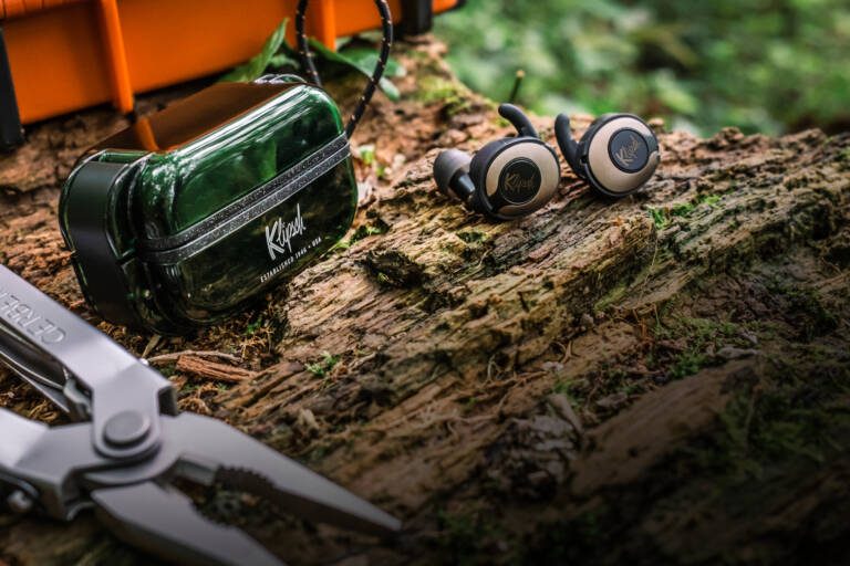 T5 II True Wireless Sport earphones placed in the forest