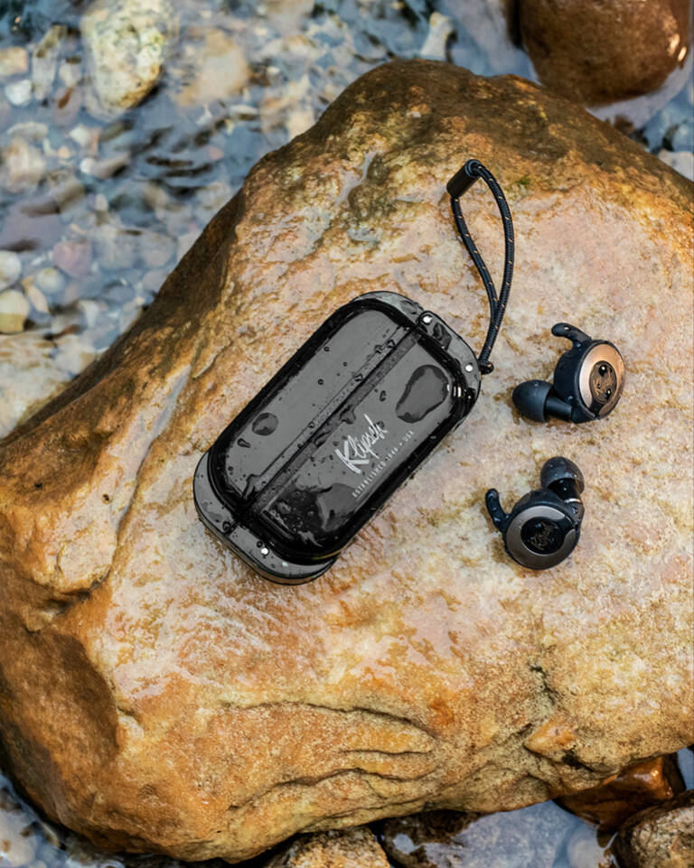 T5 II True Wireless Sport earphones placed on a rock in a stream Mobile