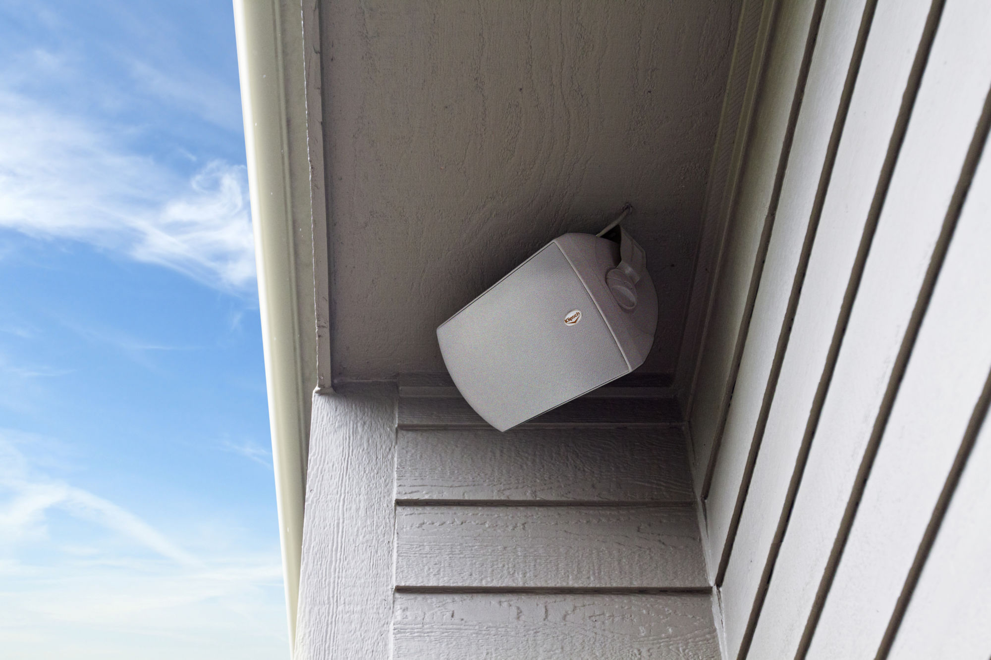 AW-650 Outdoor Speaker mounted to a house