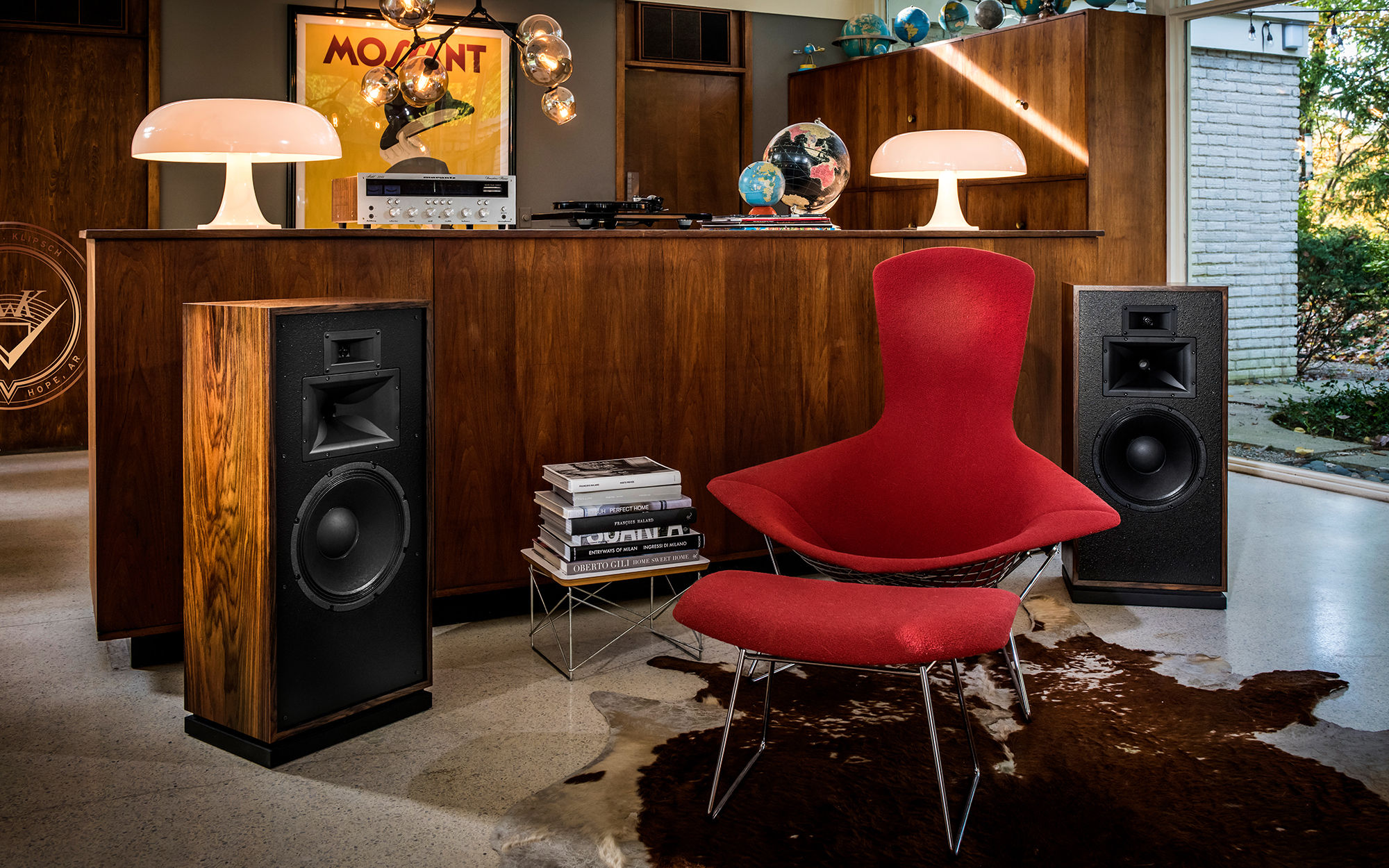 Klipsch Forte III speakers in front of a home wooden bar