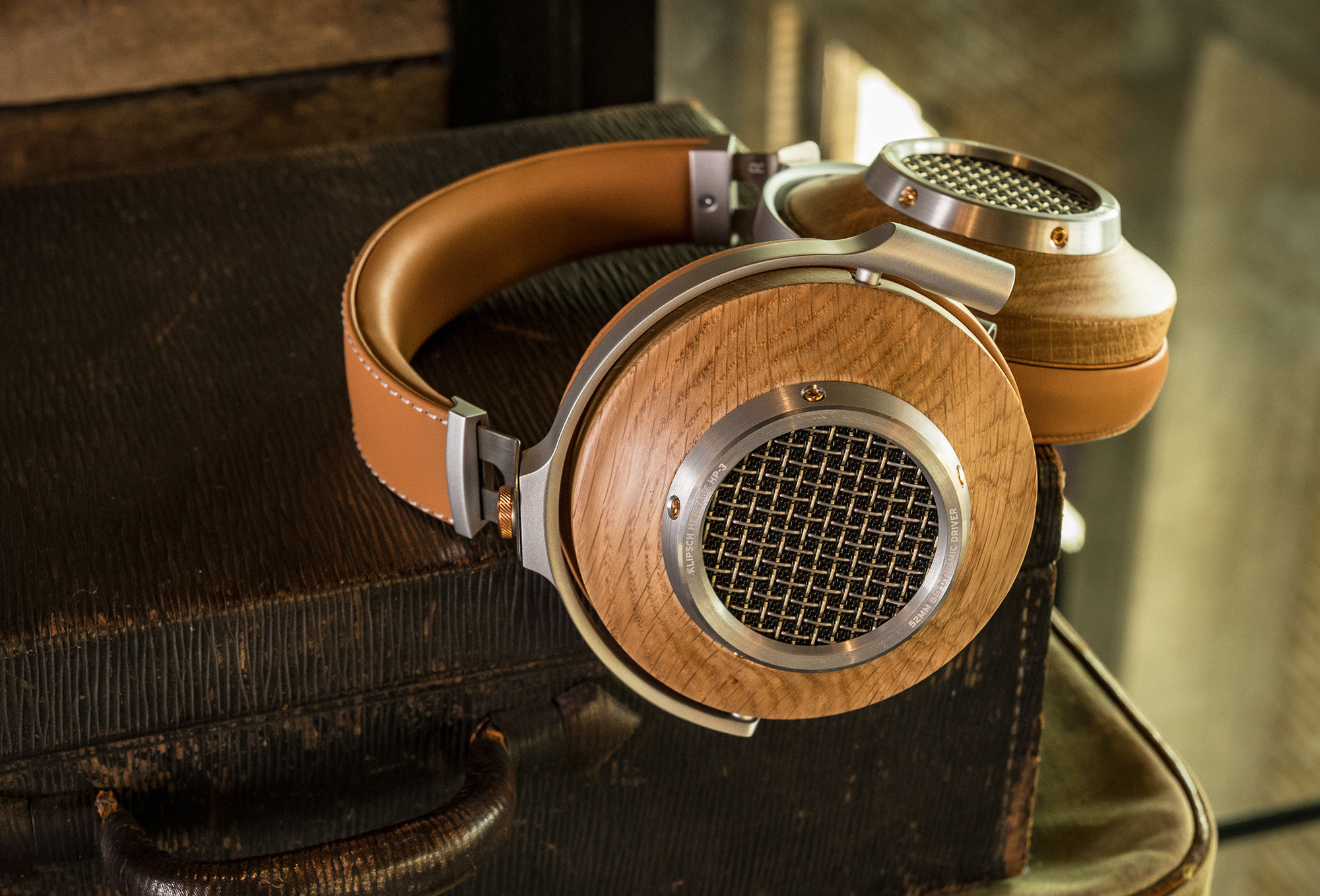 Heritage HP-3 Headphones lying on a case