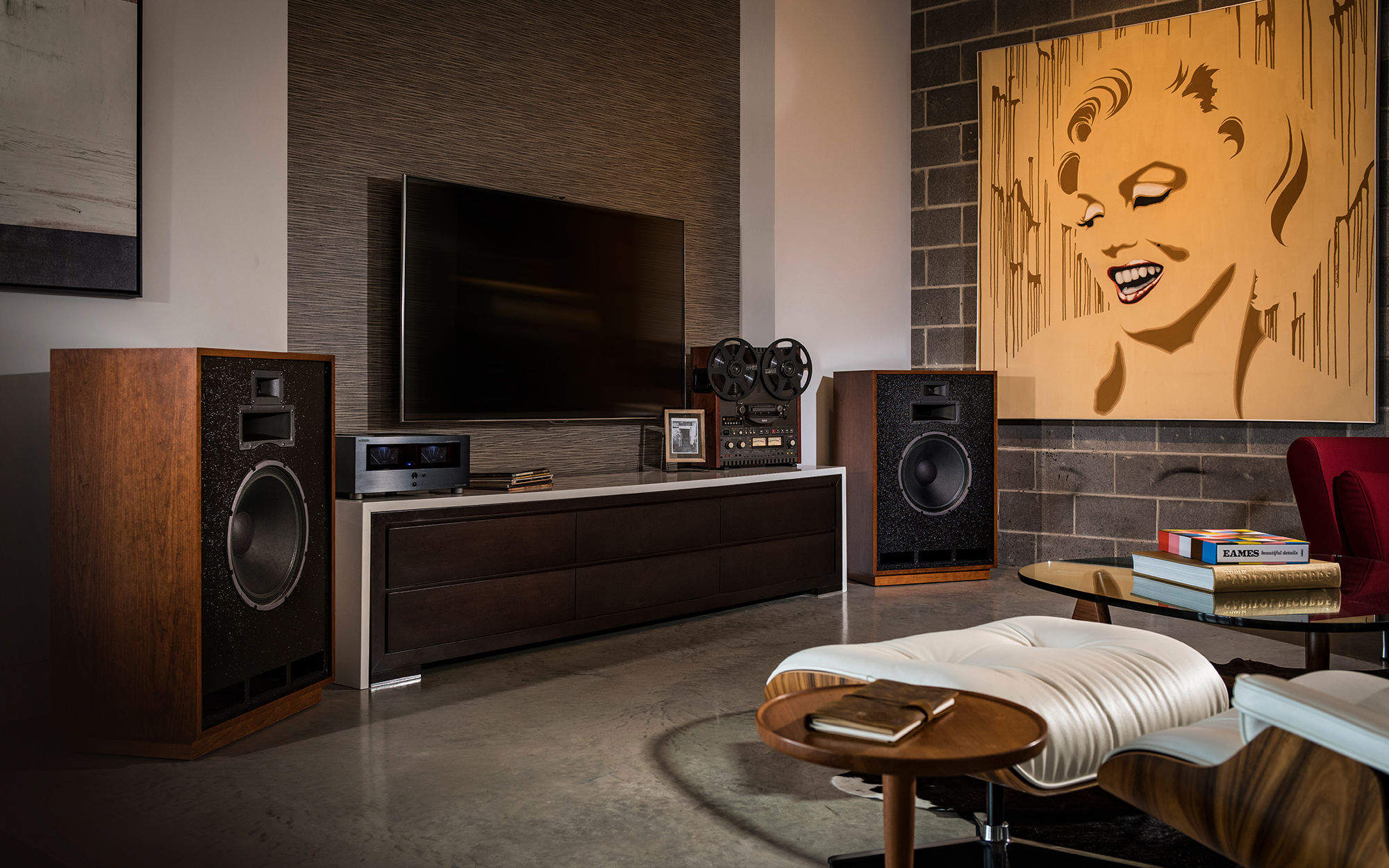 2 Cornwall III floorstanding speakers flanking a tv in a living room