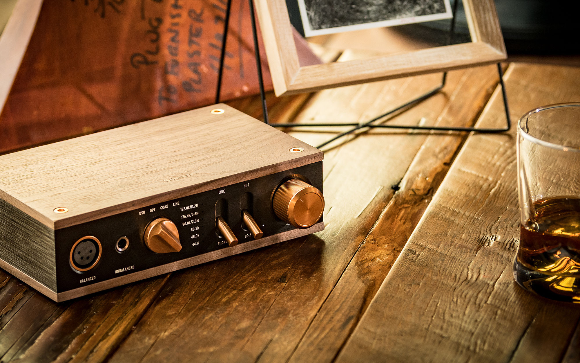 Heritage Headphone Amplifier on wooden table with glass of scotch