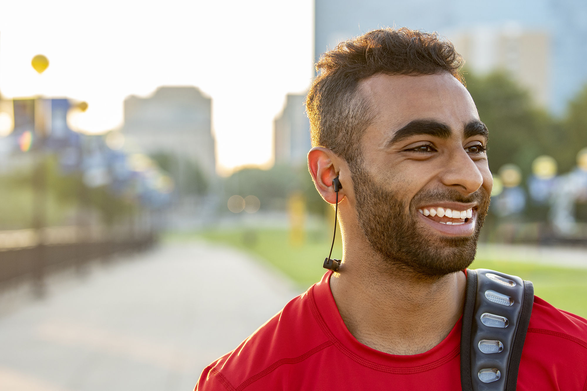 Man smiling while listening to R5 wireless headphones
