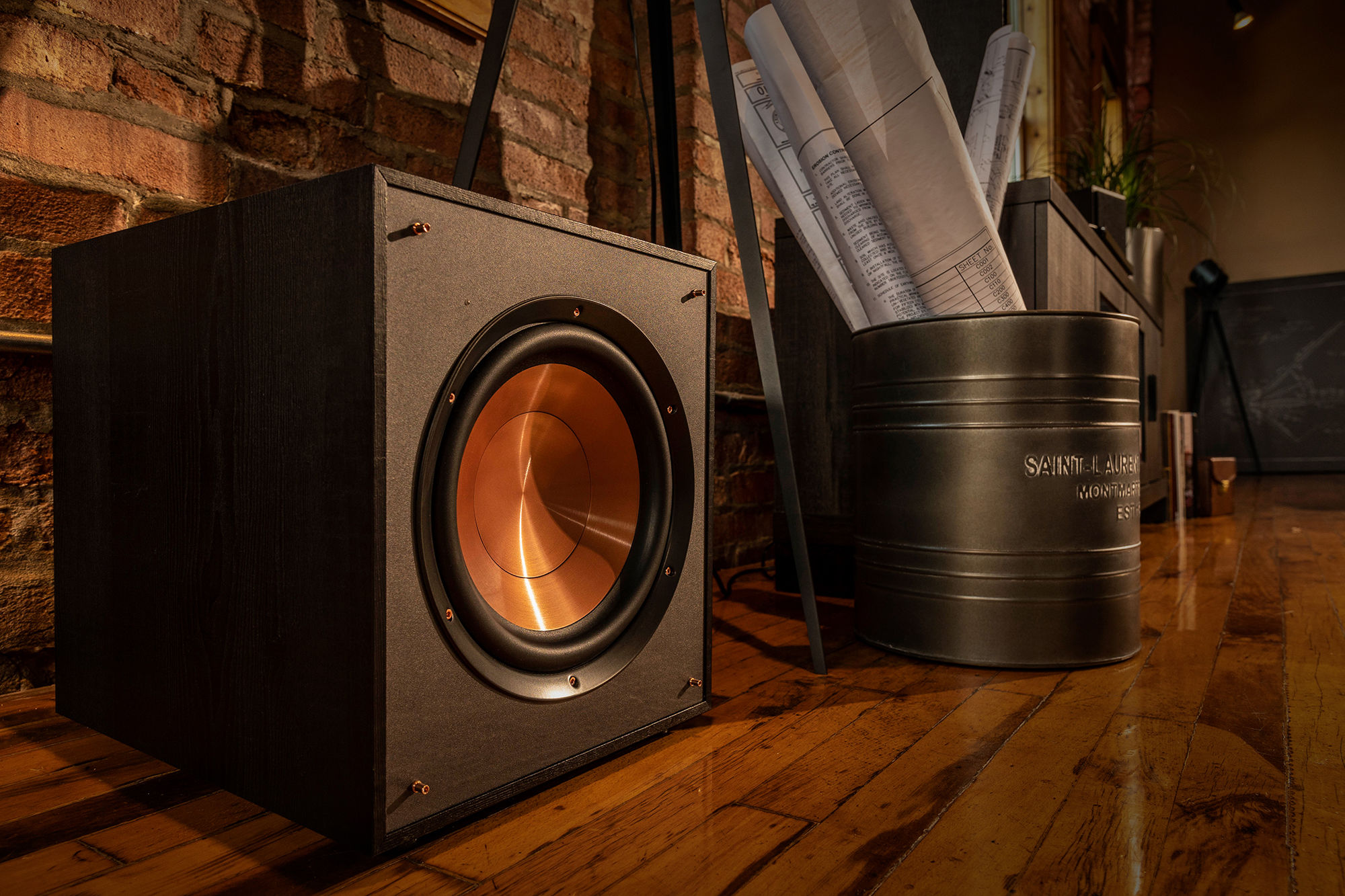 Klipsch Reference Subwoofer next to a bucket full of blueprints