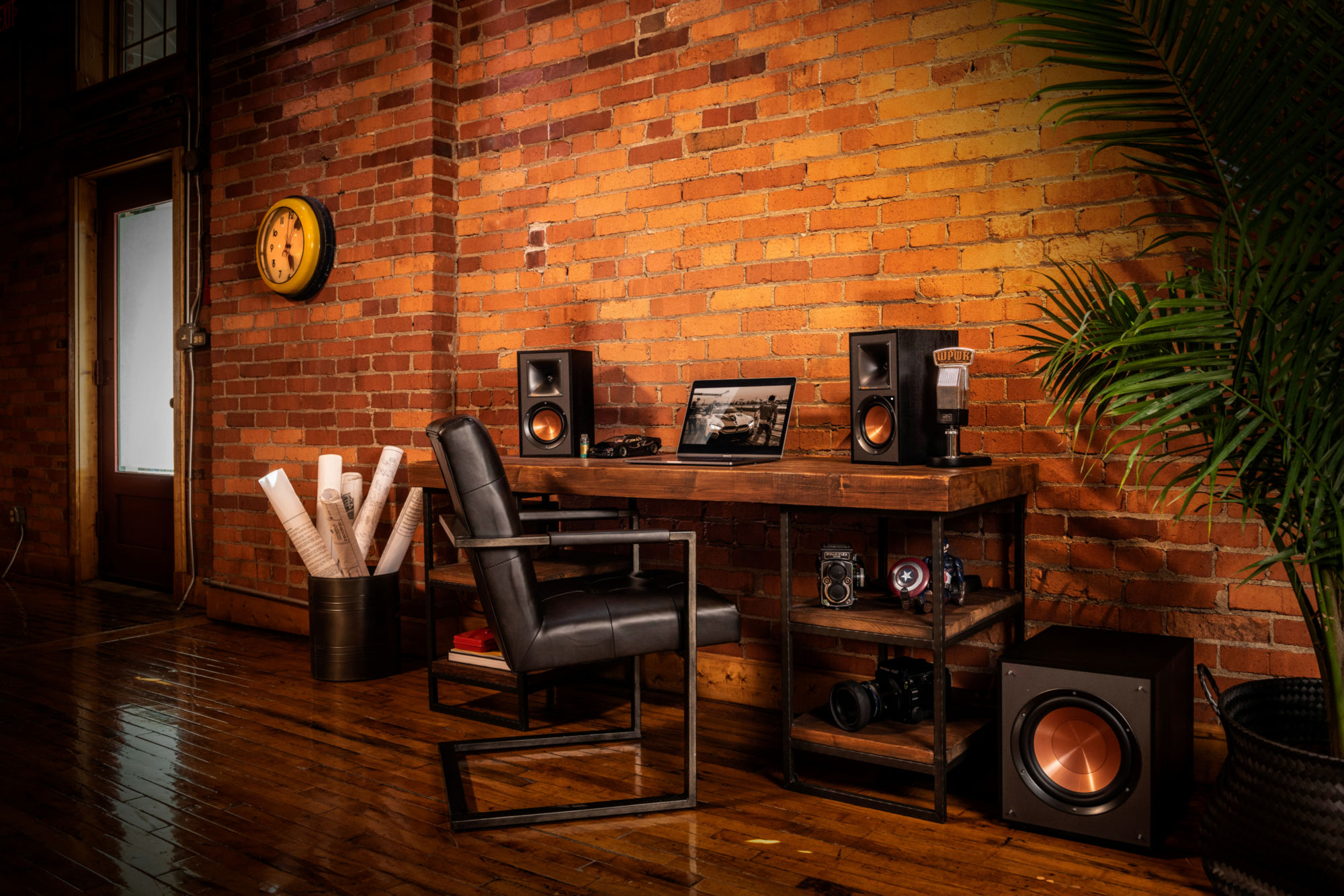 Klipsch Reference Powered Speakers on a desk with a laptop