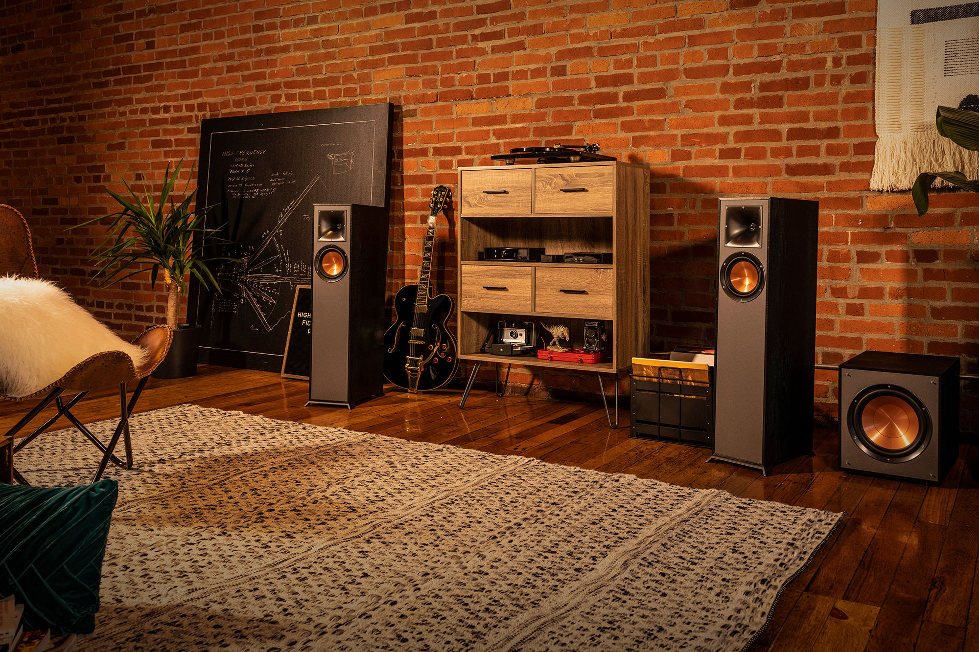 R-610F speakers with a guitar and wooden shelf