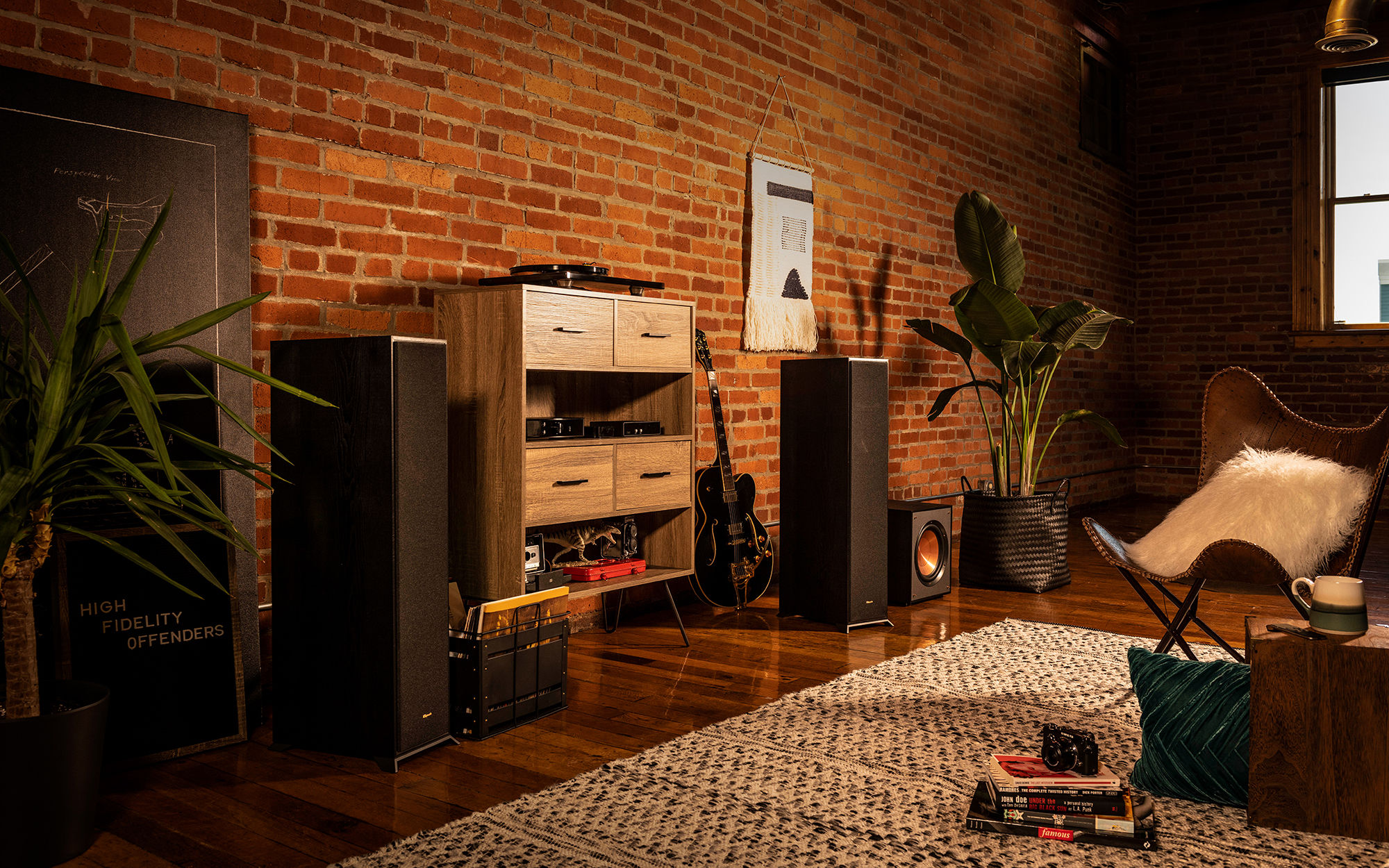 R-610F finished speakers with a guitar and wooden shelf