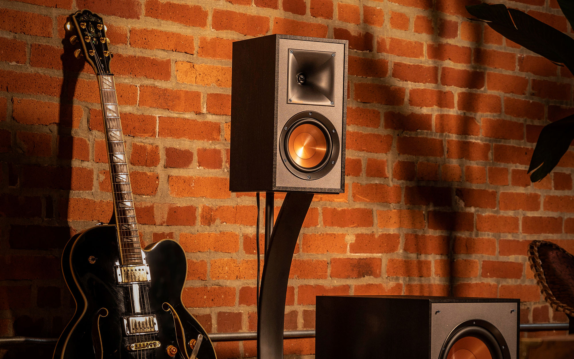 Klipsch R-51M bookshelf speaker and guitar