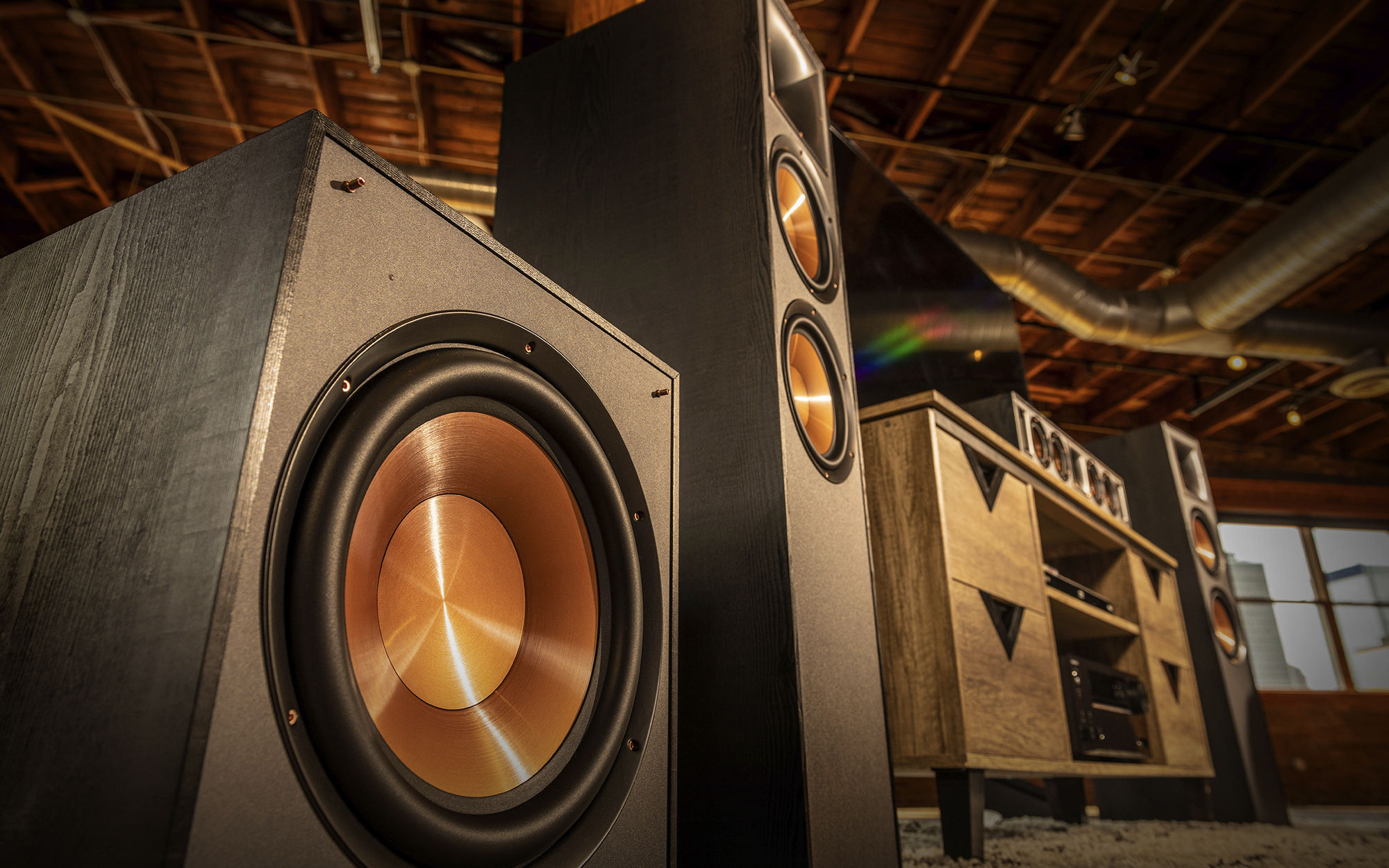 Close up of a Klipsch speaker system surrounding a tv