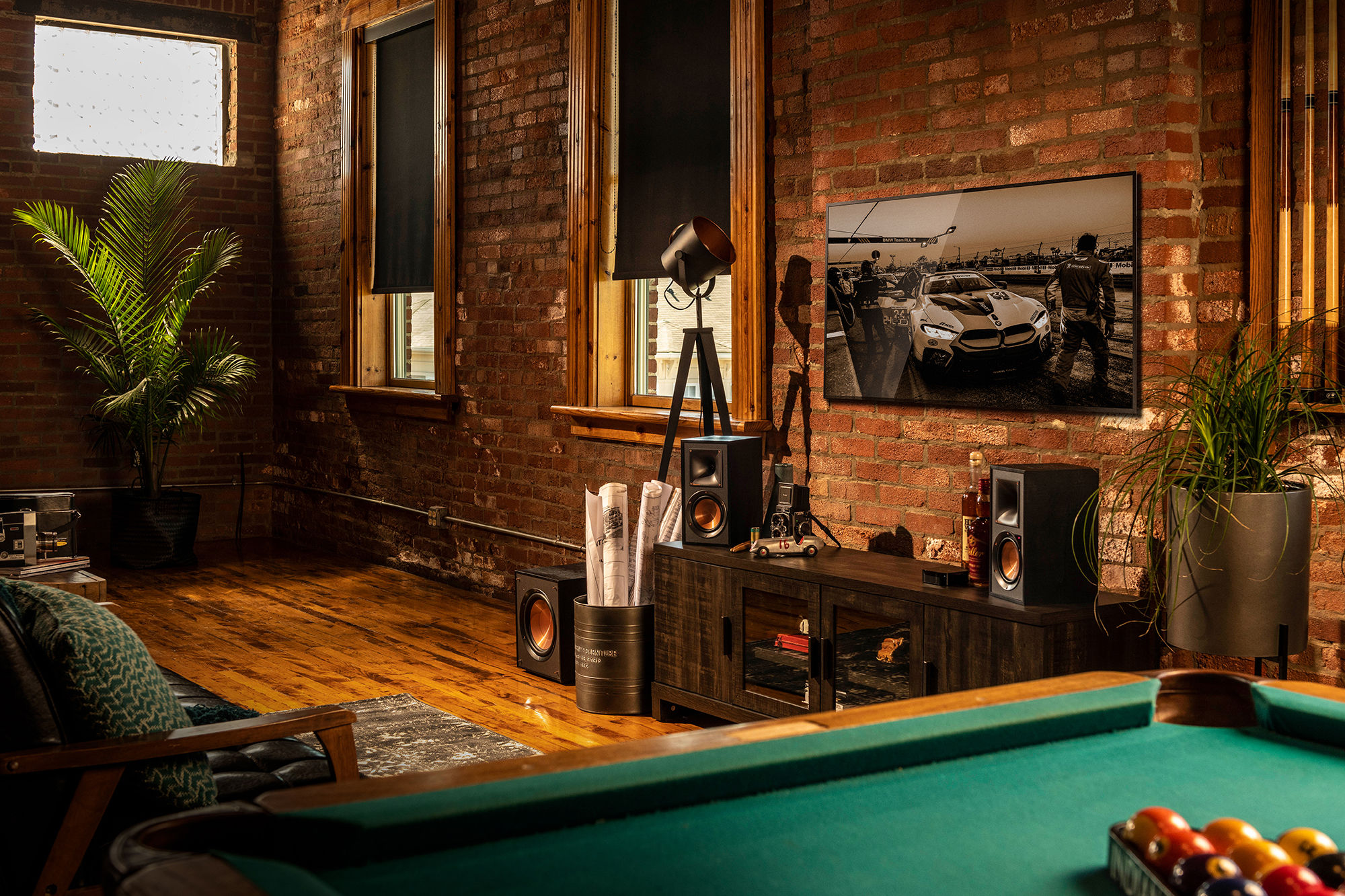 Klipsch Reference Powered Speakers by a pool table