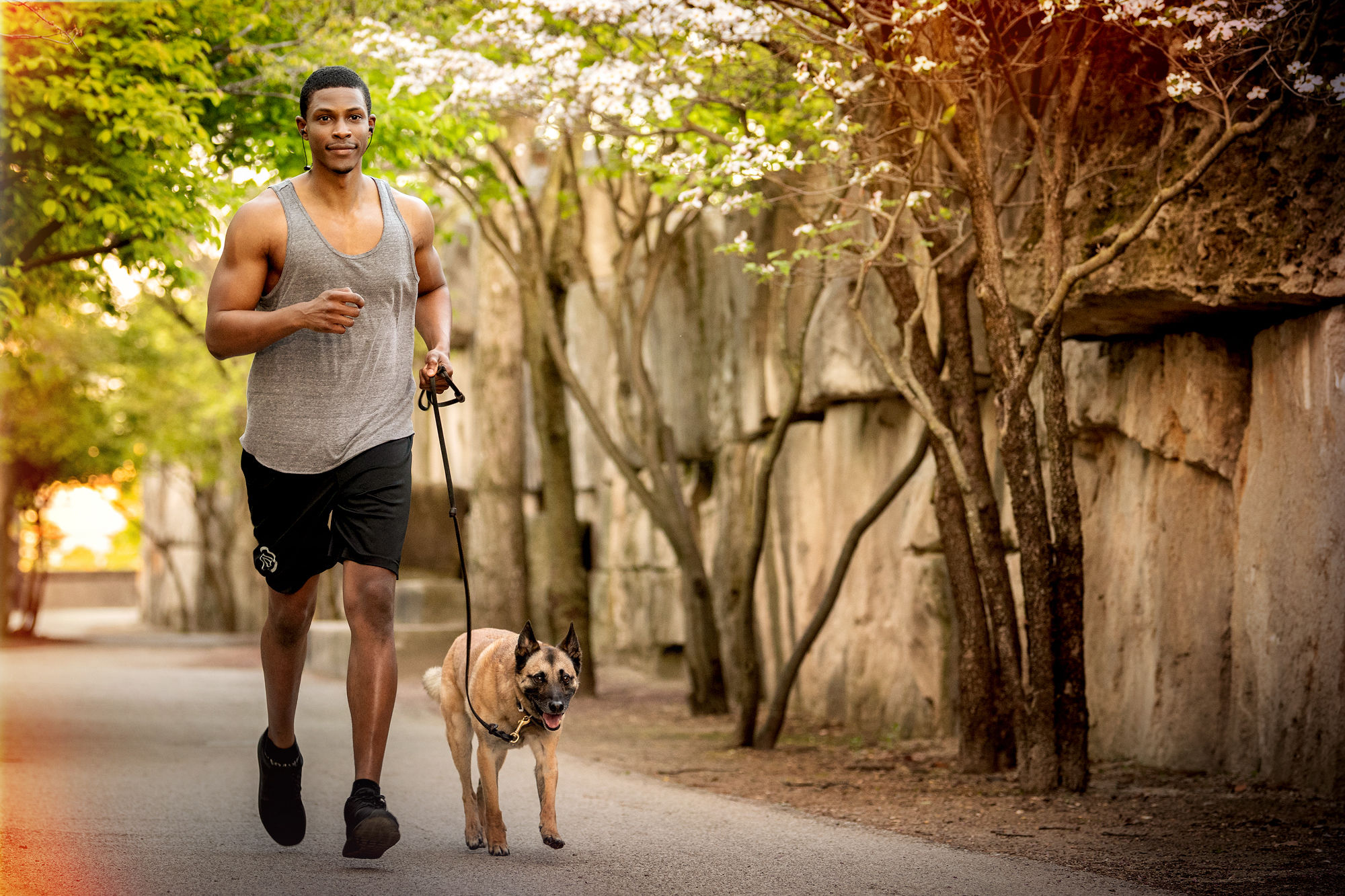 Man walks dog with Klipsch T5 Sport