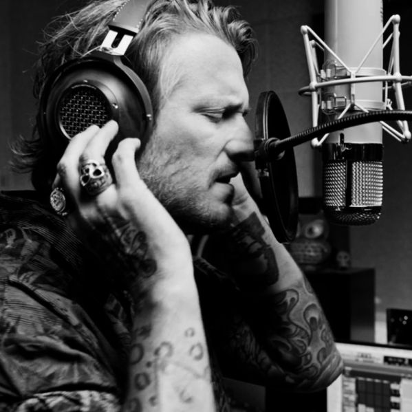 Butch Walker singing in the studio wearing Heritage HP-3 headphones