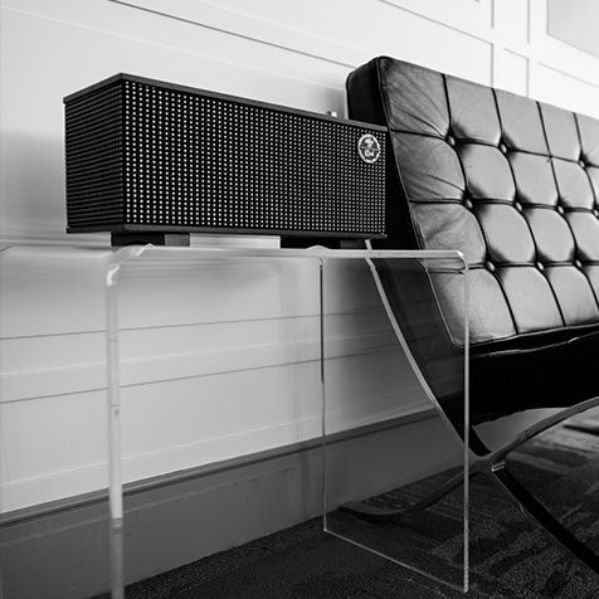 Klipsch speaker next to a black couch