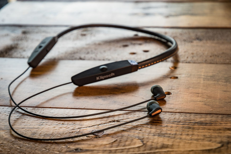 Klipsch R5 Neckband headphones on a wooden table